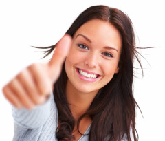 Portrait of attractive young female showing a thumbs up on white